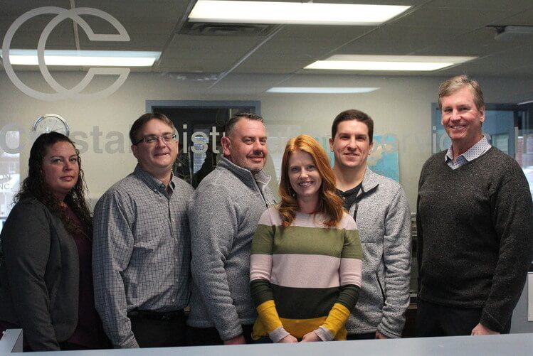 Staff members at Crystal Distribution Services, Inc.
